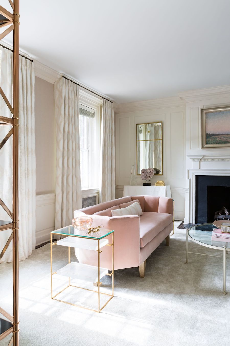 soft pink sofa with beige curtains and gold side table