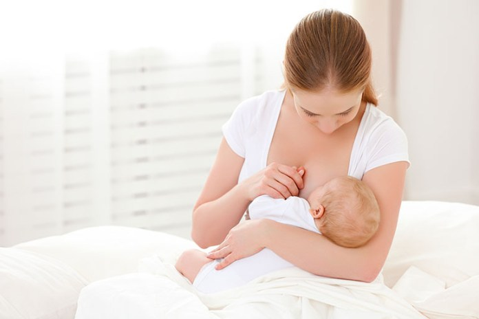 Cradle hold: 5 Best Breastfeeding Positions New Moms Must Try