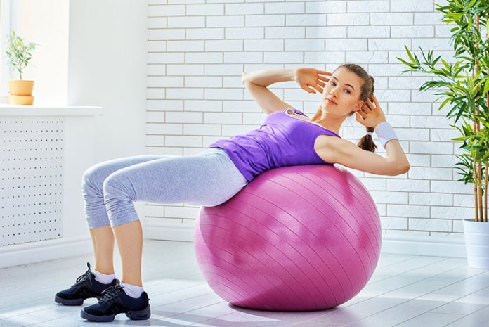 exercise-ball-crunches: best exercises to lose belly fat