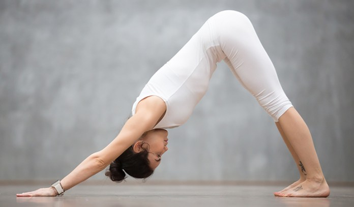 The Downward-Facing Dog (Adho Mukha Svanasana)_Yoga Asanas For Upper, Middle, and Lower Back Pain Relief