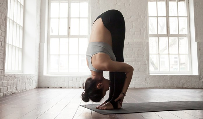 The Standing Forward Bend (Uttanasana)_Yoga Asanas For Upper, Middle, and Lower Back Pain Relief