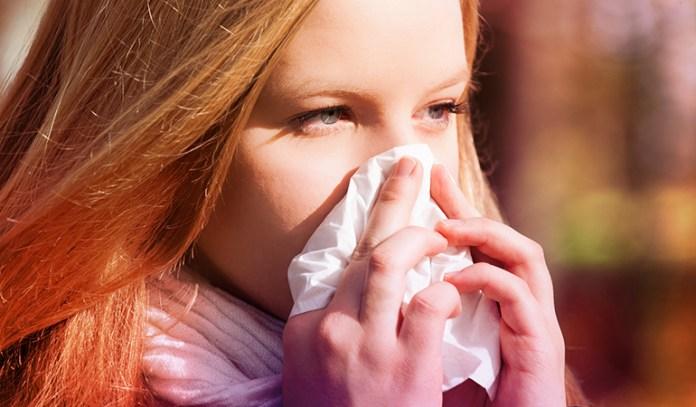 Child suffering from flu due to weak immunity.