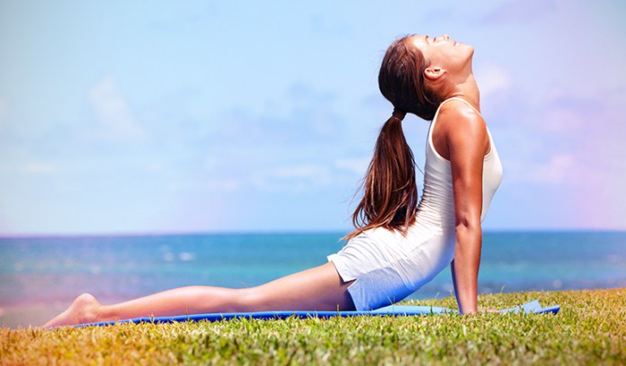 A woman in the Cobra pose yoga.
