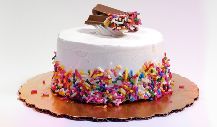 Use hot knife to cut ice cream cake