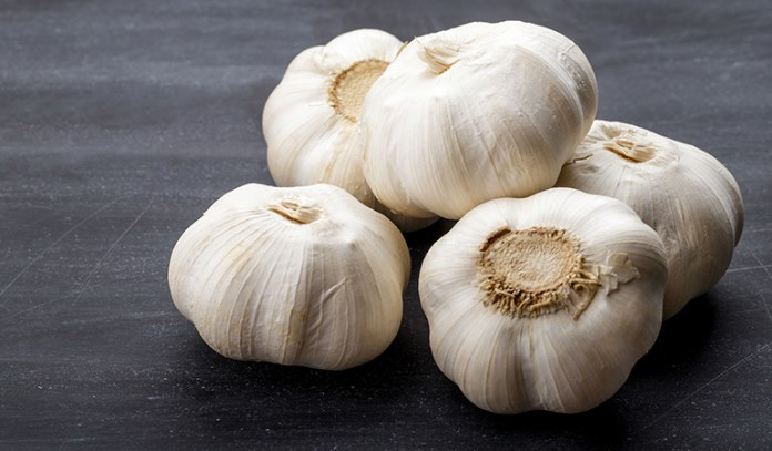 Garlic contains high amounts of allicin, a chemical that fights inflammation and kills acne- causing bacteria.