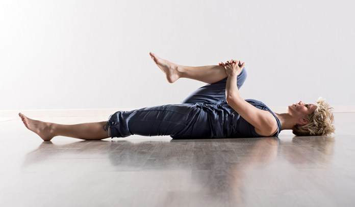 Knee to chest back stretch relieves lower back pain