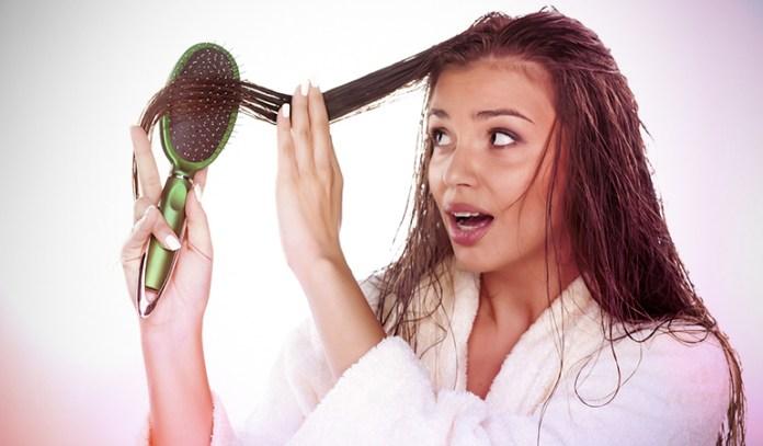 A girl combing her wet hair.