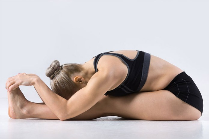 The seated forward bend pose helps relieve tight hips
