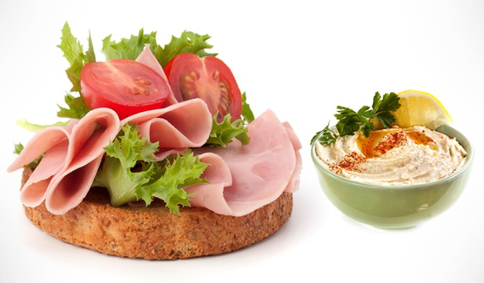 Add hummus and meat to your bread.