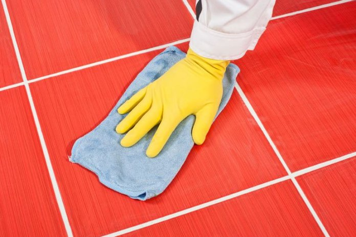 A popular trick to clean bathroom tiles is to use candle wax