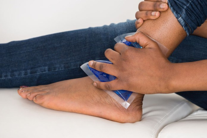 Icing a sprained ankle reduces inflammation and swelling