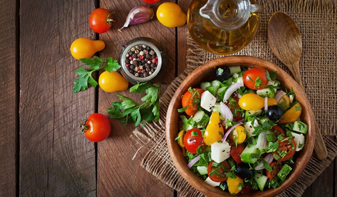 Following a Mediterranean diet that's full of fresh foods, healthy fats, and fresh herbs is suggested to help boost pregnancy.