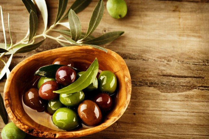 Olives release tannins which reduce nausea.