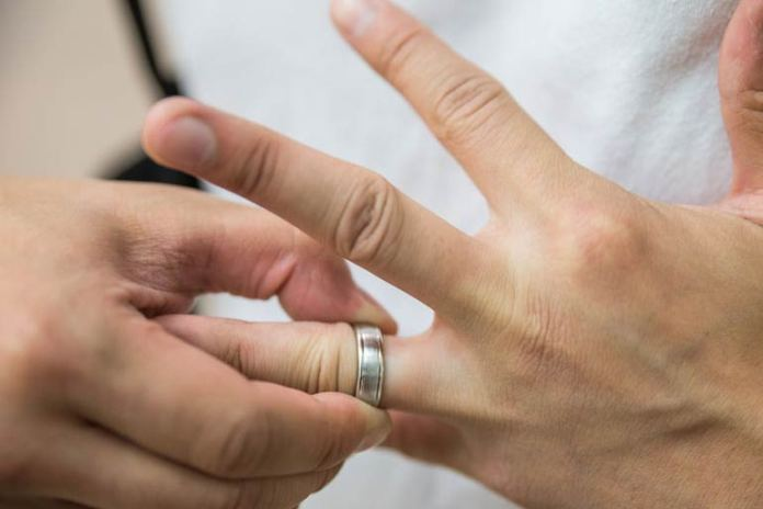 You can get the ring out from your finger using dental floss