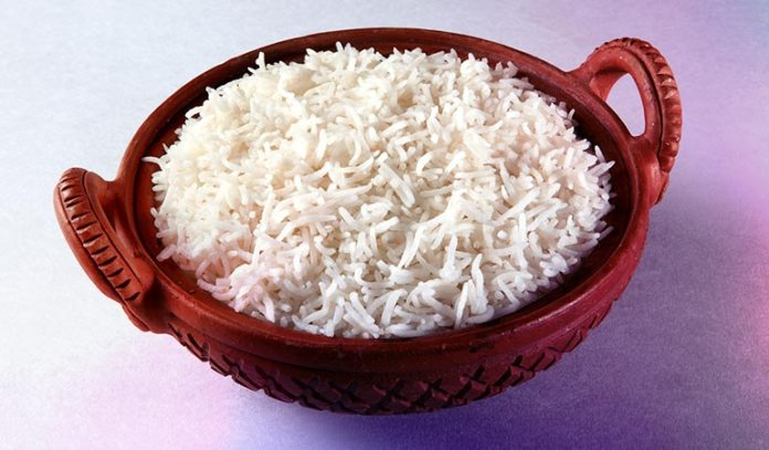 One cup of short-grain, cooked white rice contains 53 grams of total carbs.