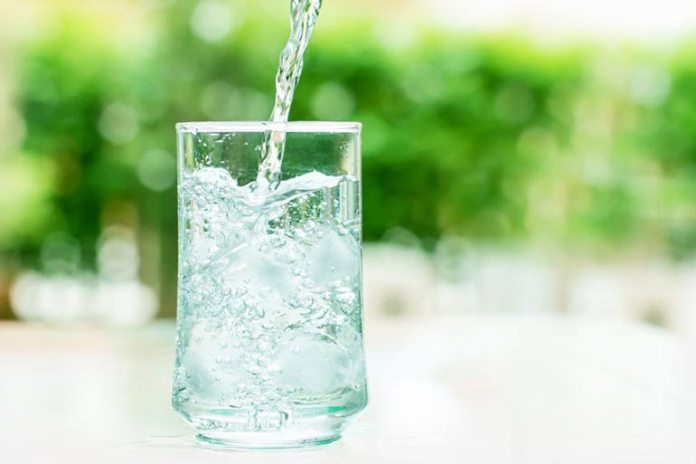 Water is a hunger suppressor which helps reduce your caloric intake