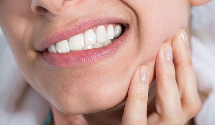 Tooth abscess can make your jawline puffier
