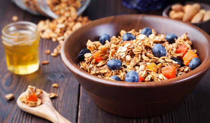 Maple nut granola with Greek yogurt and blueberries are a refreshingly healthy breakfast