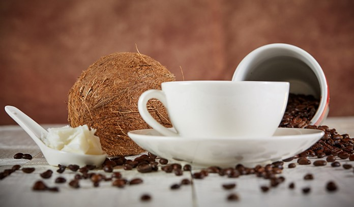 Add coconut oil to coffee or tea