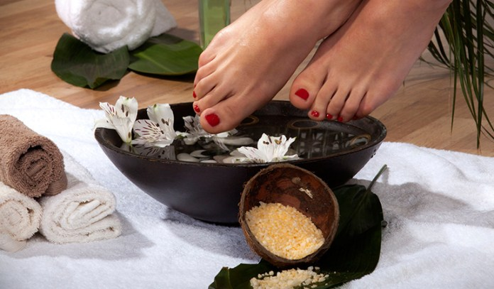 immerse feet in water with bath salts for refreshed, great smelling feet