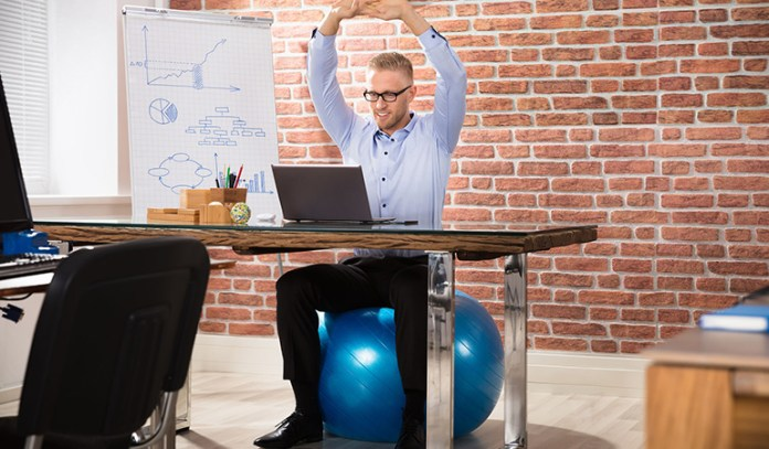 Sit on an exercise ball to stay active even with a desk job