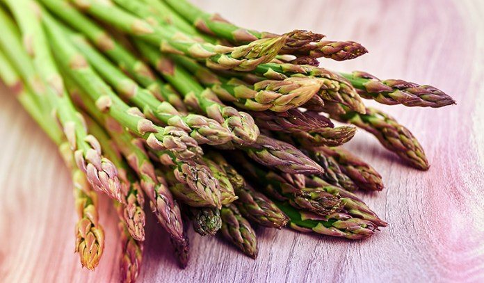 Half a cup of cooked chopped asparagus gives 45.5 mcg of vitamin K.