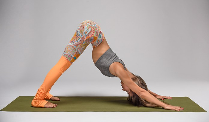 The downward facing dog strengthens the back and core muscles.