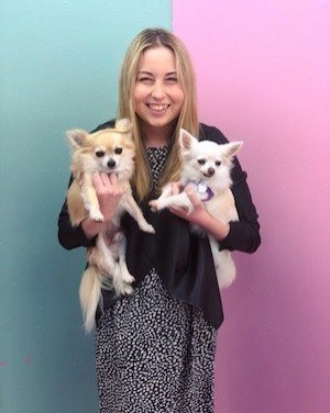 Kristen Larsen blond smiling with 2 small dogs