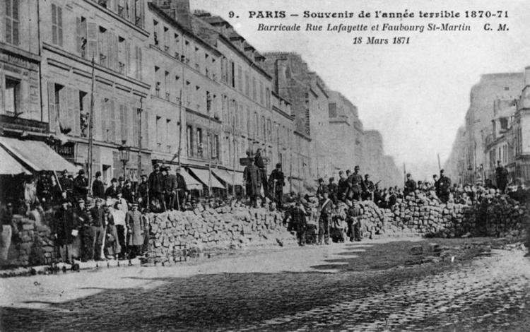 A black and white photo of The Paris Commune barricade in 1871.