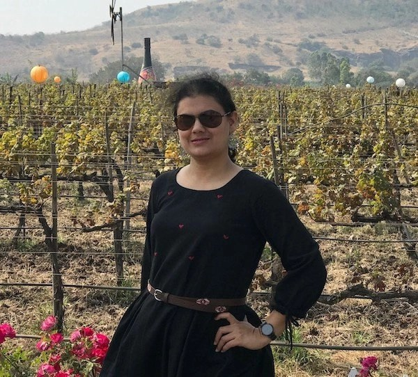 Ketki Gadre in front of vineyards