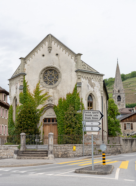 historic Swiss church covered in vines