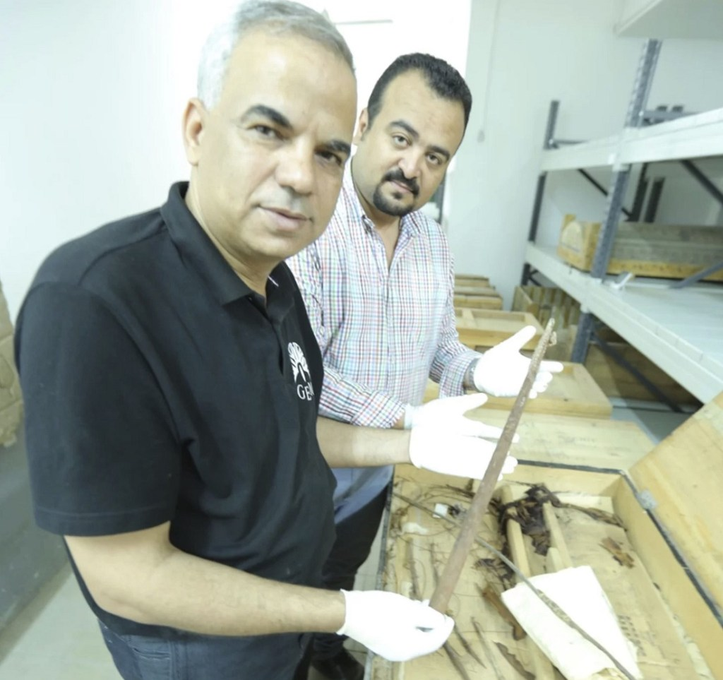 Photograph of Eissa Zidane and Mohammed Atwa looking at one of Tutankhamun's boats. Image Credit: Luxor Museum