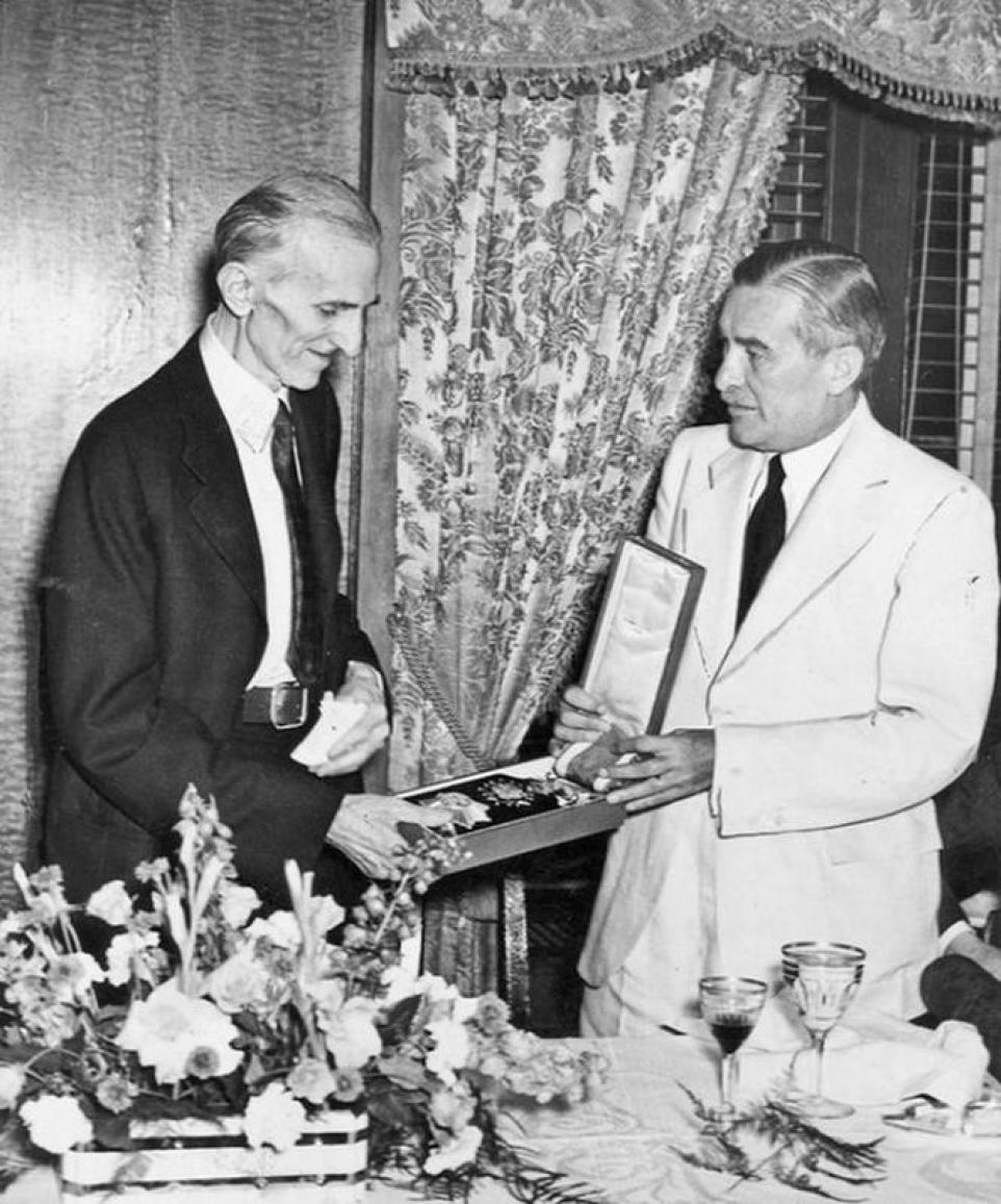 A photograph of Nikola Tesla in 1937, accepting the order of the White Lion.
