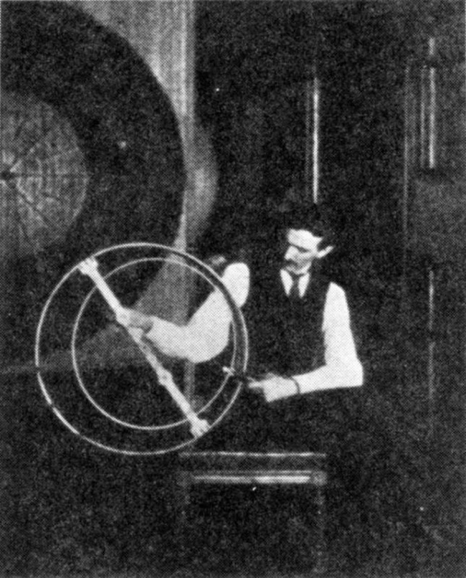Nikola Tesla performing one of his many experiments in his laboratory.