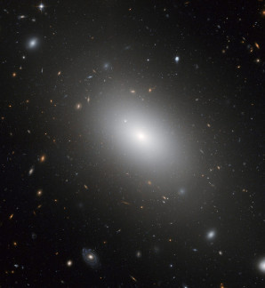 """This image of NGC 1132 was taken with Hubble's Advanced Camera for Surveys. This elliptical galaxy reveals the final result of what may have been a group of galaxies that merged together in the recent past. Another possibility is that the galaxy formed in isolation as a """"lone wolf"""" in a universe ablaze with galaxy groups and clusters."""