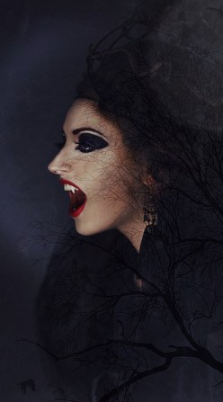 A vampire with black hair and sharp fangs stands in front of a moon and tree