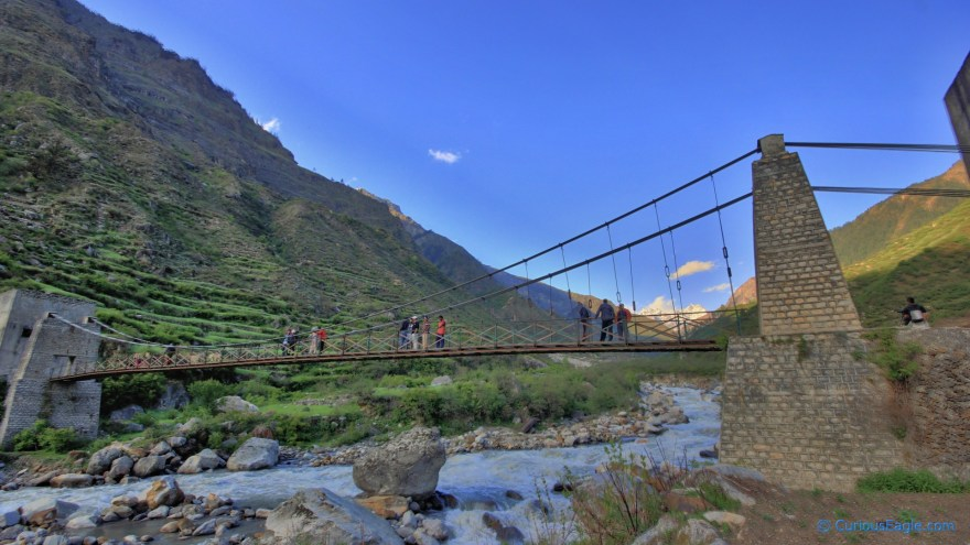 Photo of the hanging bridge on the river at Seema