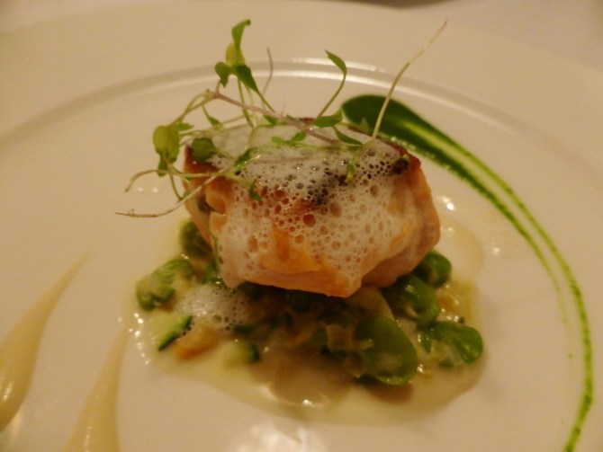 Pan-fried organic Scottish salmon, fricassee of broad beans, broccoli puree and truffle sauce.