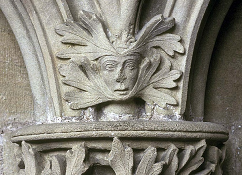 Southwell Minster green woman with oak leaves under chin and sprouting from forehead.