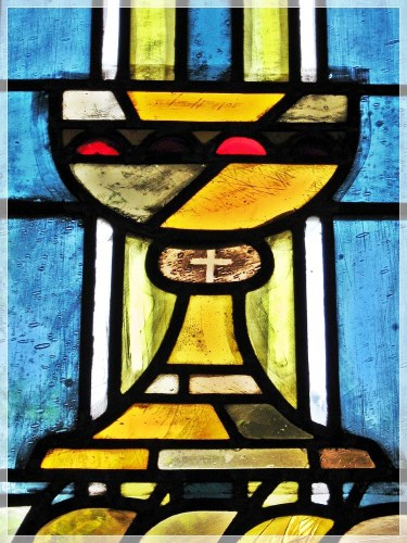 A chalice in stained glass.