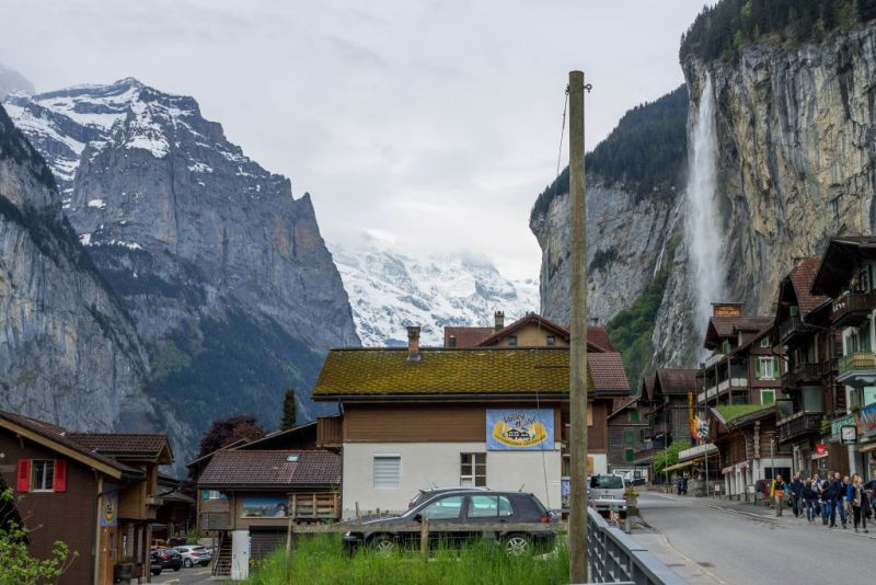 Lauterbrunnen village with waterfalls and alps in background