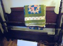 nice dark headboard... bet the quilt isn't vintage, but it's a nice green... mostly!