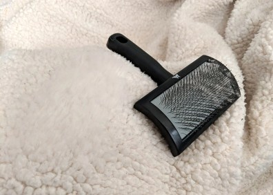 combing with the right brush breaks up clumps, removes dirt, and restores a plush texture