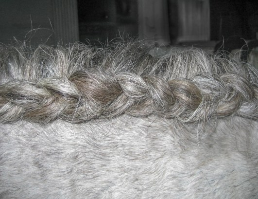 This unique braid is achieved by braiding each strand under one another.