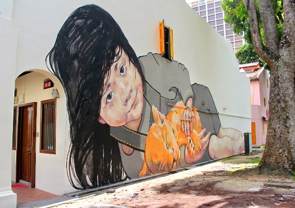 girl with lion cub mural zacharevic singapore