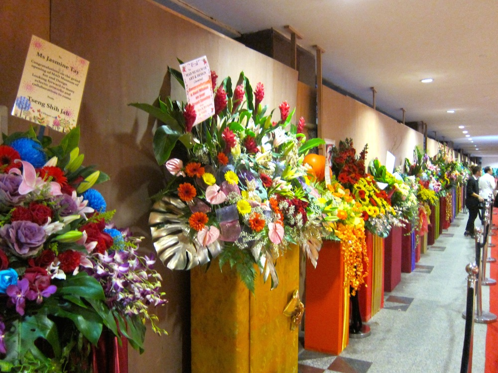 row of gifted flowers for opening of MAD | curlytraveller.com