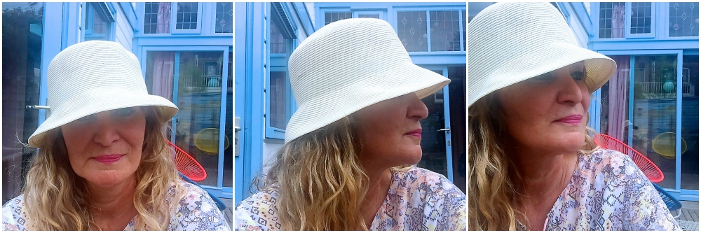Woman wearing a white summer hat |curlytraveller.com