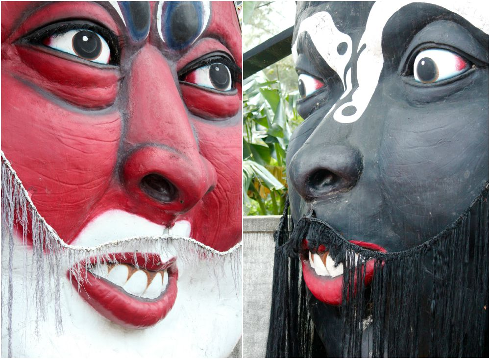 Close up of two huge masks at Tiger Balm Garden |curlytraveller.com