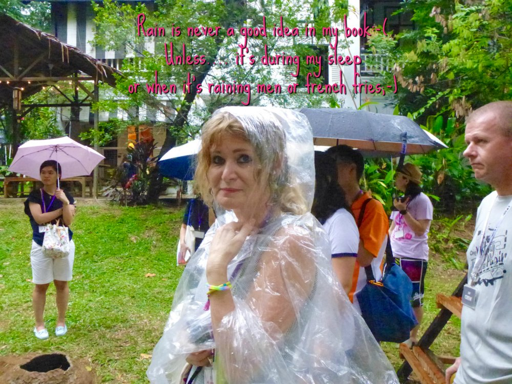 Woman in plastic rain cape in Singapore |curlytraveller.com