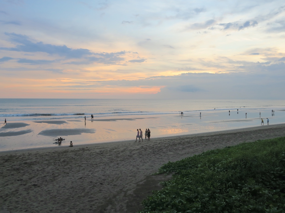 Sunset at the beach in Bali |curlytraveller.com